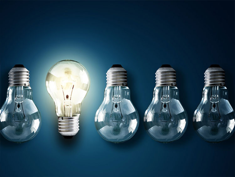 four upside down lightbulbs and one right-side up lightbulb with light on